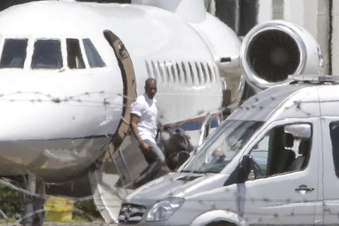 Kanye West arrives at Florence Airport